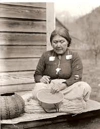 A Sto:lo woman weaving a cedar basket. Image from Wikipedia.